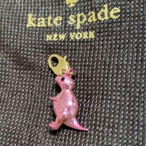 "Kate Spade ""How Charming"" Pink Dinosaur"